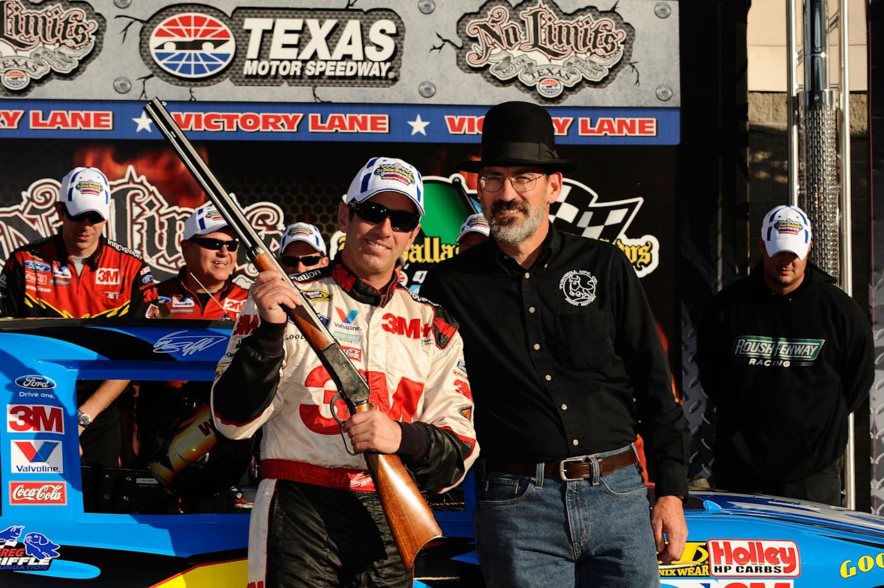 FORT WORTH, TX - NOVEMBER 04:  Greg Biffle, driver of the #16 3M Scotch-Blue Painter's Tape Ford, celebrates with Doug Turnbull after setting the pole position in qualifying for the NASCAR Sprint Cup Series AAA Texas 500 at Texas Motor Speedway on November 4, 2011 in Fort Worth, Texas.  (Photo by Jared C. Tilton/Getty Images for NASCAR)