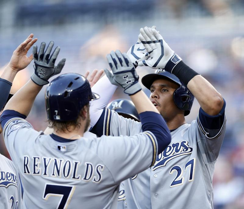 Reynolds hits grand slam, Brewers beat Braves 6-1