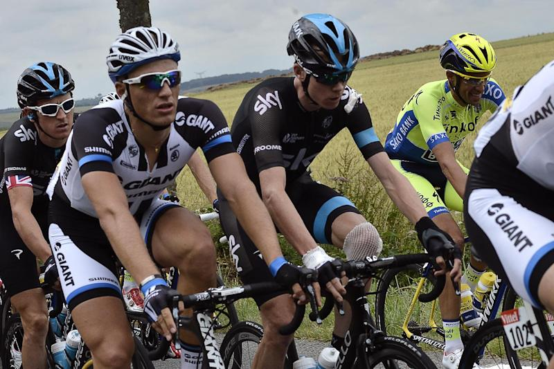 Britain's Christopher Froome (C) rides after a fall next to Germany's Marcel Kittel (2nd L), Spain's Alberto Contador (R), and Britain's Geraint Thomas (L) during the 163.5 km fourth stage of the Tour de France on July 8, 2014