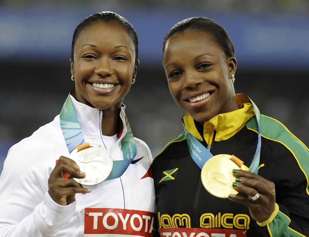 Jamaica's Veronica Campbell-Brown, right, poses with her gold medal alongside silver medalist Carmelita Jeter of the U.S. during the medal ceremony for the Women's 200m at the World Athletics Championships in Daegu, South Korea, Saturday, Sept. 3, 2011. (AP Photo/Martin Meissner)