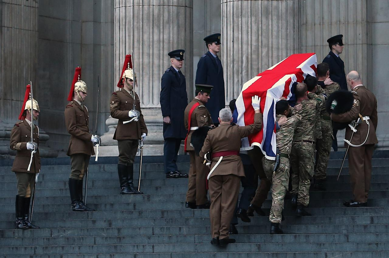 LONDON, ENGLAND - APRIL 15:  A flag draped coffin is carried during a full military rehearsal for the ceremonial funeral procession for former British Prime Minister Margaret Thatcher outside St Paul's Cathedral in the early morning on April 15, 2013 in London, England. On Wednesday April 17, over 2,000 guests including global political figures and celebrities will attend the funeral of Margaret Thatcher at St Paul's Cathedral. The service will include 700 serving Armed Forces personnel, and will be led by the Band of the Royal Marines. The 87 year-old former prime minister died after suffering a stroke on April 8.  (Photo by Dan Kitwood/Getty Images)