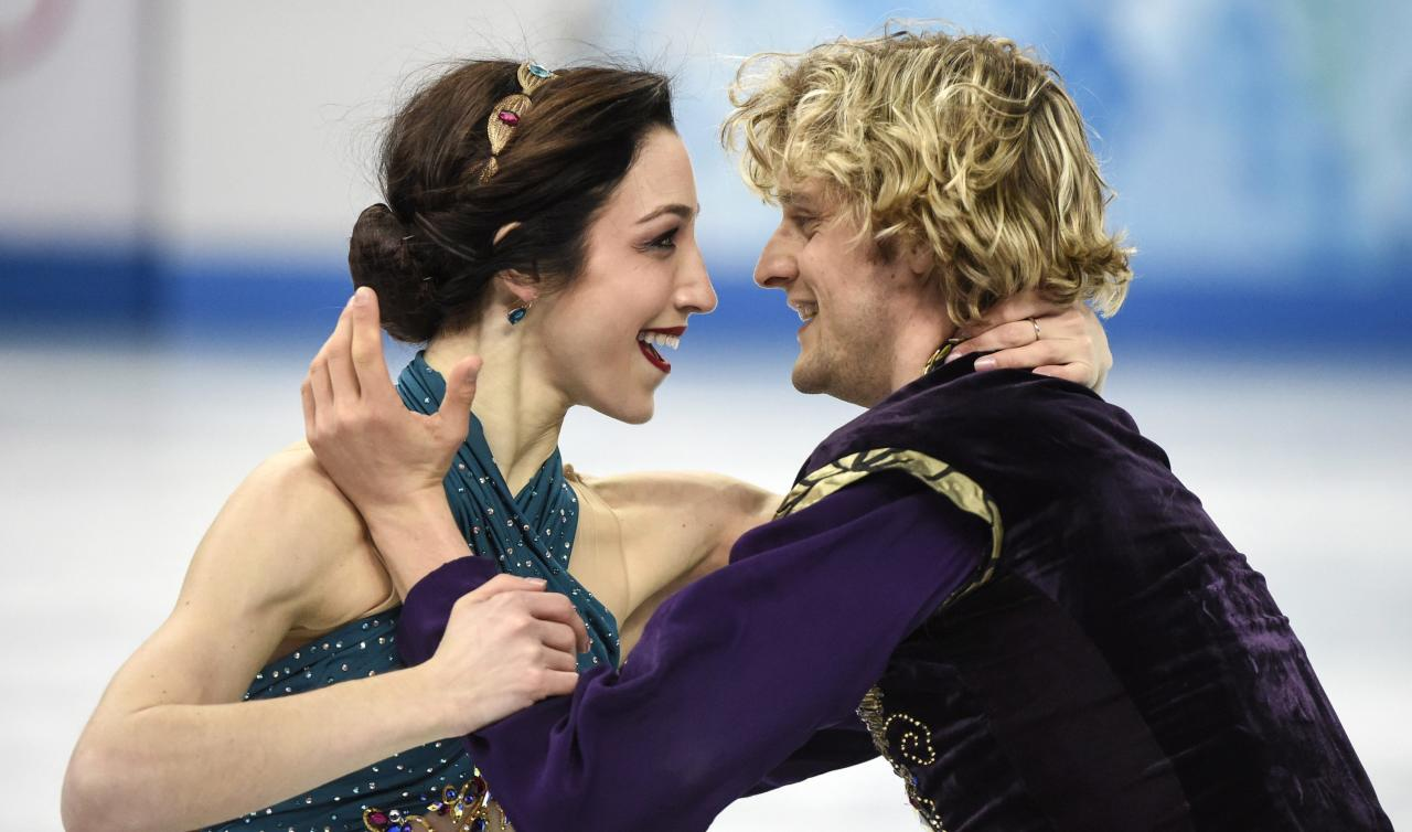 Meryl Davis, left, and Charlie White, of the United States, perform their free dance in the ice dance portion of the team figure skating event at the Winter Olympics, Sunday, Feb. 9, 2014, in Sochi, Russia. (AP Photo/The Canadian Press, Paul Chiasson)
