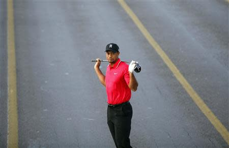 U.S. golfer Woods poses during an event to promote the upcoming Turkish Airlines Open golf tournament