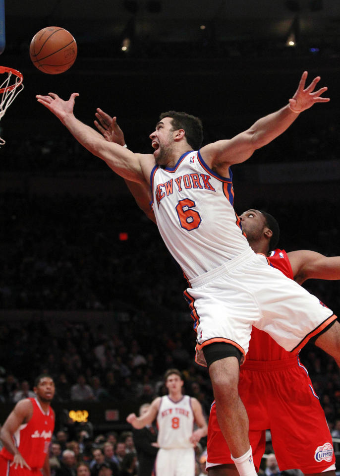 New York Knicks' Landry Fields drives past Los Angeles Clippers' Ike Diogu during the first half of an NBA basketball game Wednesday, Feb. 9, 2011, in New York.