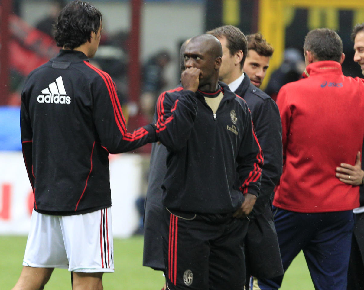 AC Milan midfielder Clarence Seedorf, of the Netherlands, gestures prior to the start of a Serie A soccer match between AC Milan and Genoa, at the San Siro stadium in Milan, Italy, Saturday, April 14, 2012. The Italian football federation has called off all league games this weekend after the death of Livorno midfielder Piermario Morosini during a Serie B match against Pescara, in Pescara, central Italy, Saturday, April 14, 2012. (AP Photo/{Luca Bruno)