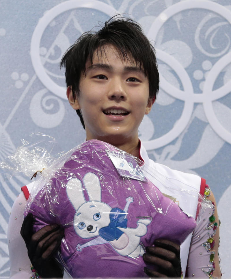 Japan celebrates Hanyu's history-making gold medal