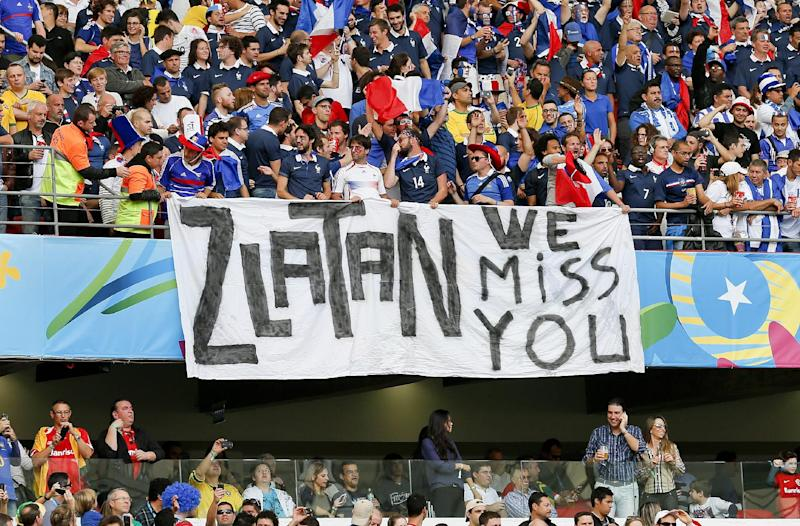 French supporters hold a banner referring to Swedish player Zlatan Ibrahimovic before the group E World Cup soccer match between France and Honduras at the Estadio Beira-Rio in Porto Alegre, Brazil, Sunday, June 15, 2014. Zlatan plays for PSG in the French league and is not in Brazil as Sweden did not qualify