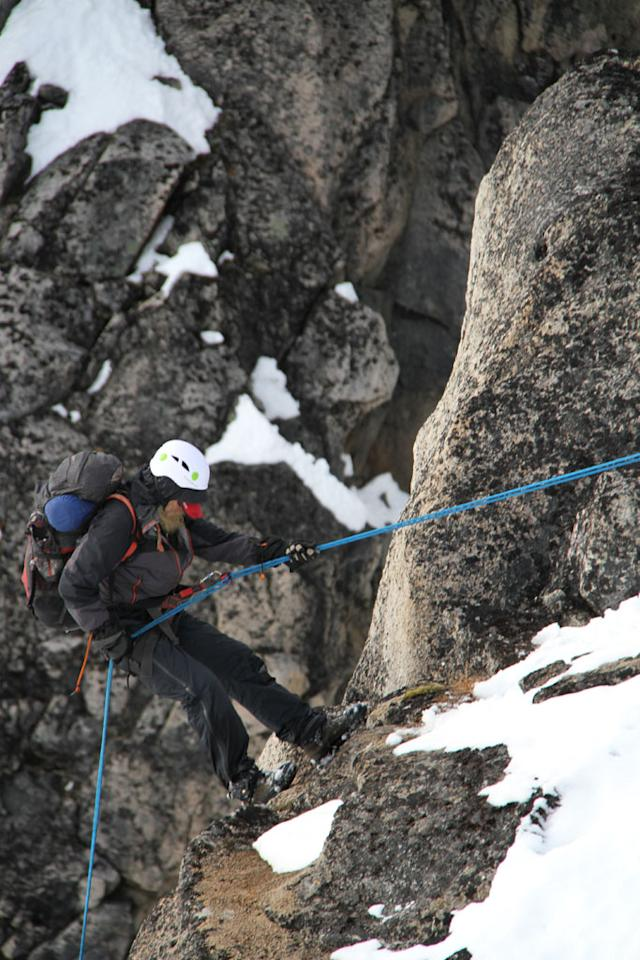 Tordrillo Mountains, Alaska: Willi Prittie going first down the large cliff in high winds.