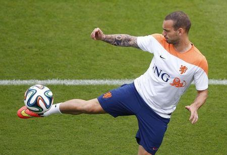 Netherlands' Sneijder kicks ball during training session in Rio de Janeiro