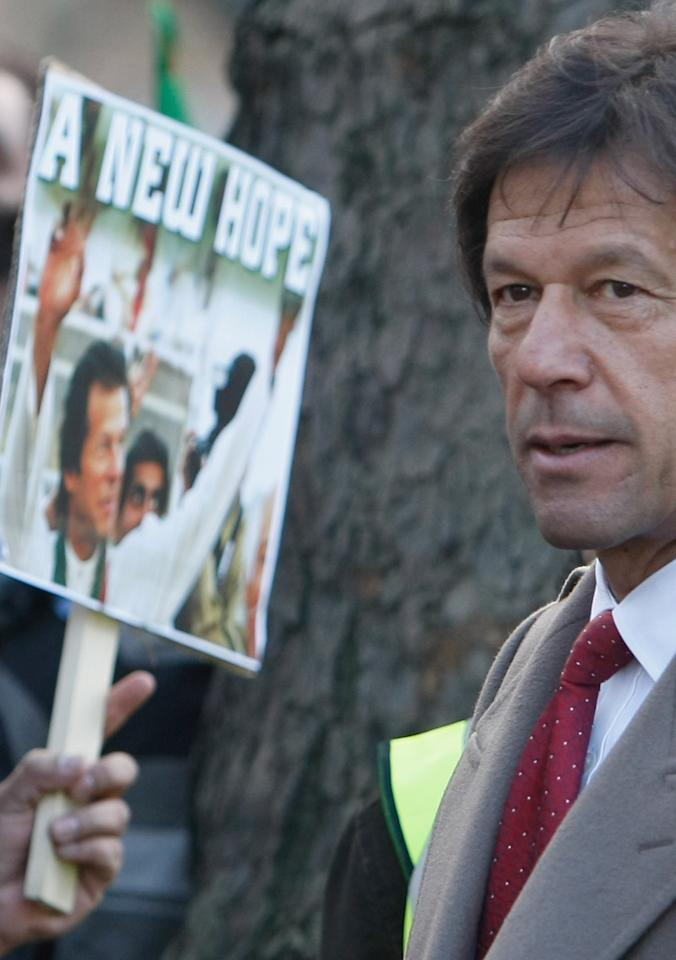 LONDON - JANUARY 28:  Imran Khan, Chairman of Pakistan Tehreek-e-Insaf, aka Movement for Justice meets with protestors outside of Downing St on January 28, 2008 in London, England. Protestors gathered outside of Downing St in protest of President Musharraffs visit to London.  (Photo by Daniel Berehulak/Getty Images)