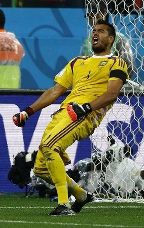 Argentina's goalkeeper Sergio Romero celebrates saving the match deciding penalty in their 2014 World Cup semi-finals against Netherlands at the Corinthians arena in Sao Paulo