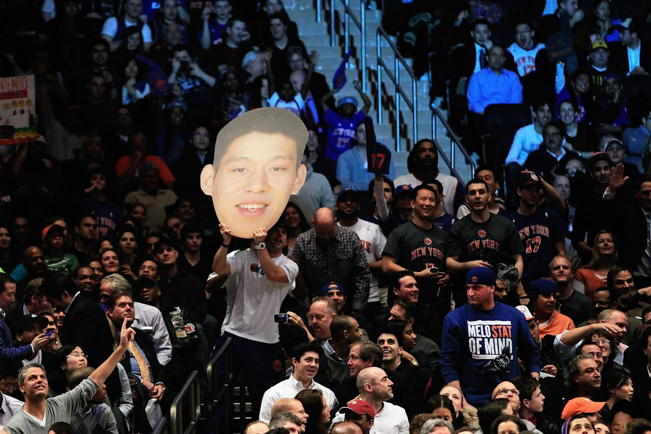 NEW YORK, NY - FEBRUARY 15: Jeremy Lin #17 of the New York Knicks fans cheer him on against the Sacramento Kings at Madison Square Garden on February 15, 2012 in New York City. NOTE TO USER: User expressly acknowledges and agrees that, by downloading and/or using this Photograph, user is consenting to the terms and conditions of the Getty Images License Agreement.  (Photo by Chris Trotman/Getty Images)