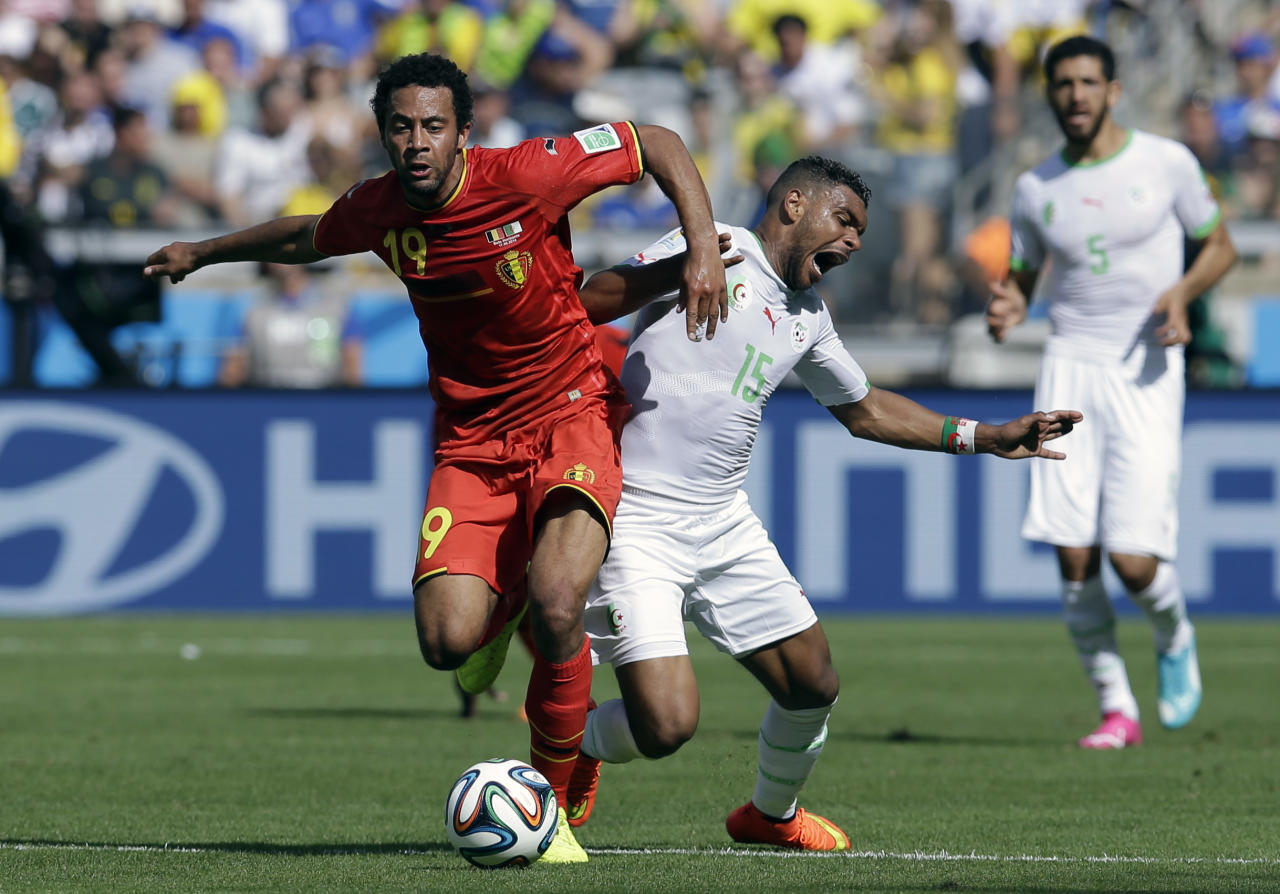 Belgium's Mousa Dembele, left, and Algeria's El Arbi Hillel Soudani battle for the ball during the group H World Cup soccer match between Belgium and Algeria at the Mineirao Stadium in Belo Horizonte, Brazil, Tuesday, June 17, 2014. (AP Photo/Hassan Ammar)