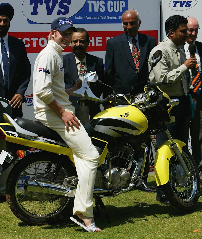 BANGALORE, INDIA - OCTOBER 10:  Michael Clarke of Australia poses on the motorbike presented to him as man of the match after day five of the First Test between India and Australia played at the Chinnaswamy Stadium on October 10, 2004 in Bangalore, India. (Photo by Hamish Blair/Getty Images)