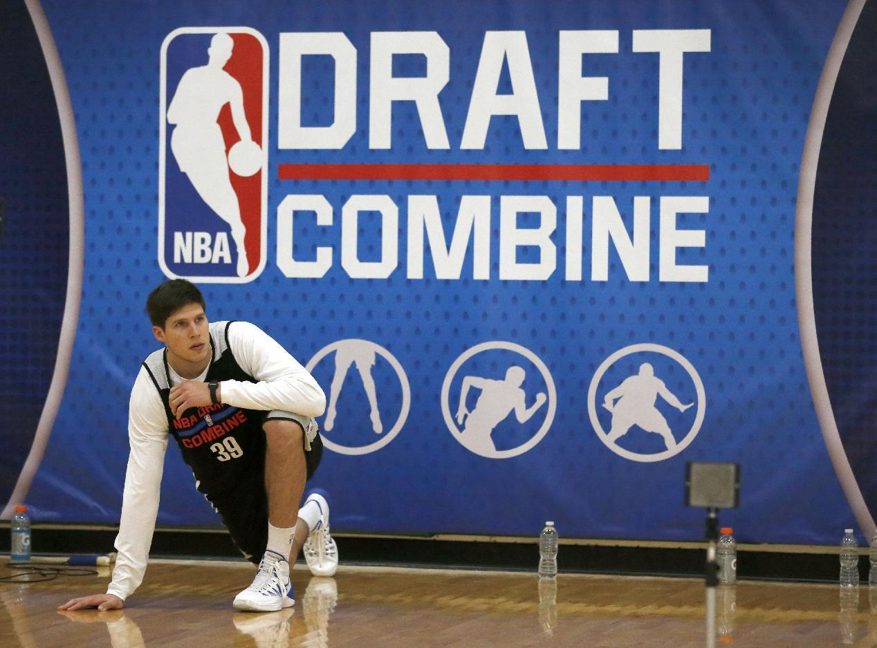 Doug McDermott, from Creighton, stretches before participating in the 2014 NBA basketball draft combine Friday, May 16, 2014, in Chicago. (AP Photo/Charles Rex Arbogast)
