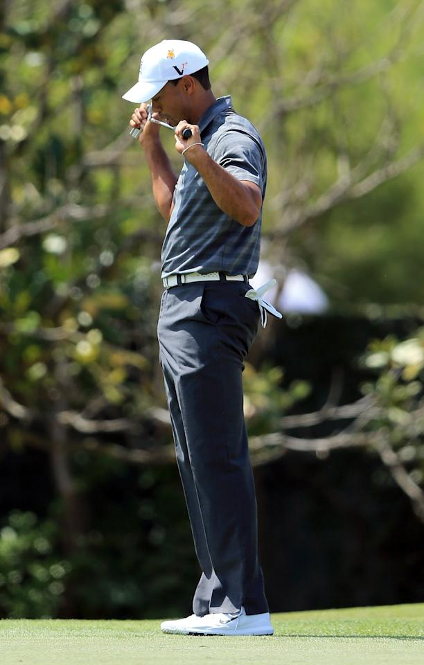 ORLANDO, FL - MARCH 24:  Tiger Woods of the USA bites his putter in frustration as his birdie attemp just misses at the par 4, 1st hole during the third round of the 2012 Arnold Palmer Invitational presented by MasterCard at Bay Hill Club and Lodge on March 24, 2012 in Orlando, Florida.  (Photo by David Cannon/Getty Images)