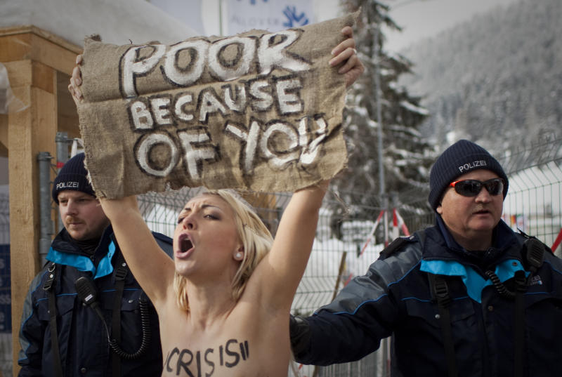 Topless protesters detained at Davos forum