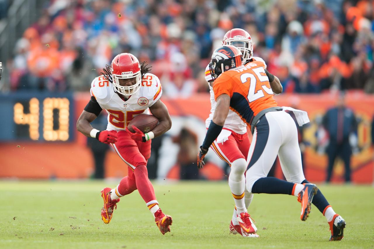 DENVER, CO - DECEMBER 30:  Running back Jamaal Charles #25 of the Kansas City Chiefs rushes against the Denver Broncos during a game at Sports Authority Field Field at Mile High on December 30, 2012 in Denver, Colorado.  (Photo by Dustin Bradford/Getty Images)