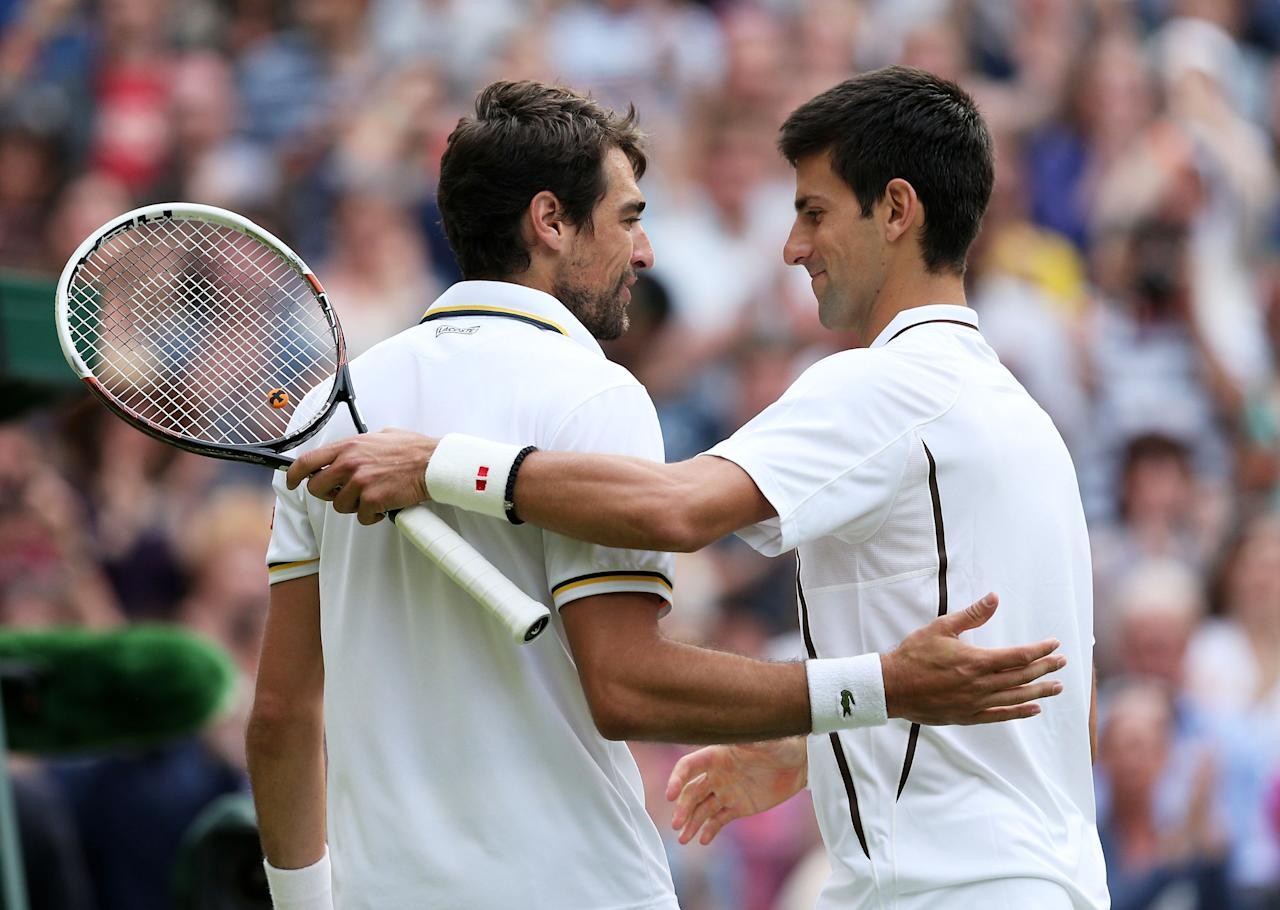 LONDON, ENGLAND - JUNE 29: Novak Djokovic of Serbia shakes hands at the net with Jeremy Chardy of France after their Gentlemen's Singles third round match on day six of the Wimbledon Lawn Tennis Championships at the All England Lawn Tennis and Croquet Club on June 29, 2013 in London, England. (Photo by Clive Brunskill/Getty Images)
