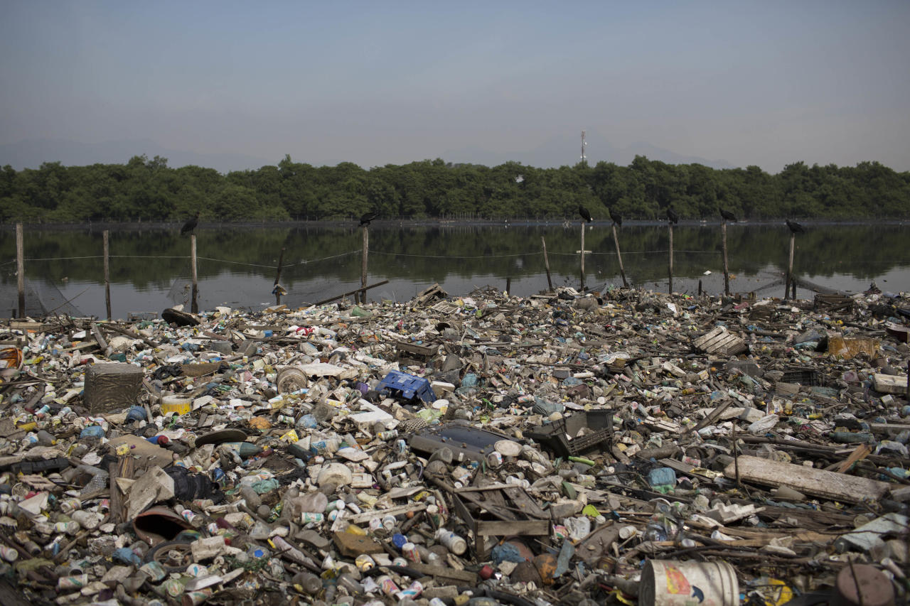 In this May 15, 2014 photo, trash floats on a polluted water channel that flows into the Guanabara Bay in Rio de Janeiro, Brazil. In its 2009 Olympic bid, officials promised that the city's waterways would be cleaned up but Brazil will not make good on its commitment to clean up Rio de Janeiro's sewage-filled Guanabara Bay by the 2016 Olympic Games. Little progress has been made on the clean up, and with just over two years to go until the Olympics, nearly 70 percent of the sewage in the metropolitan area of 12 million inhabitants continues to flow untreated, along with thousands of tons of garbage daily, into area rivers, the bay and even Rio's famed beaches like Copacabana and Ipanema. (AP Photo/Felipe Dana)