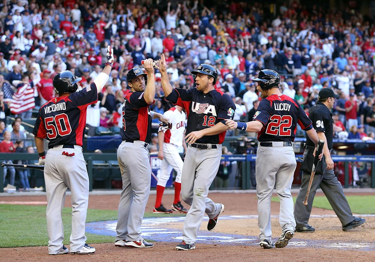 PHOENIX, AZ - MARCH 10:  Ben Zobrist #12 of USA high fives David Wright #5, Shane Victorino #50 and Jonathan Lucroy #22 after scoring against Canada during the ninth inning of the World Baseball Classic First Round Group D game at Chase Field on March 10, 2013 in Phoenix, Arizona.  (Photo by Christian Petersen/Getty Images)