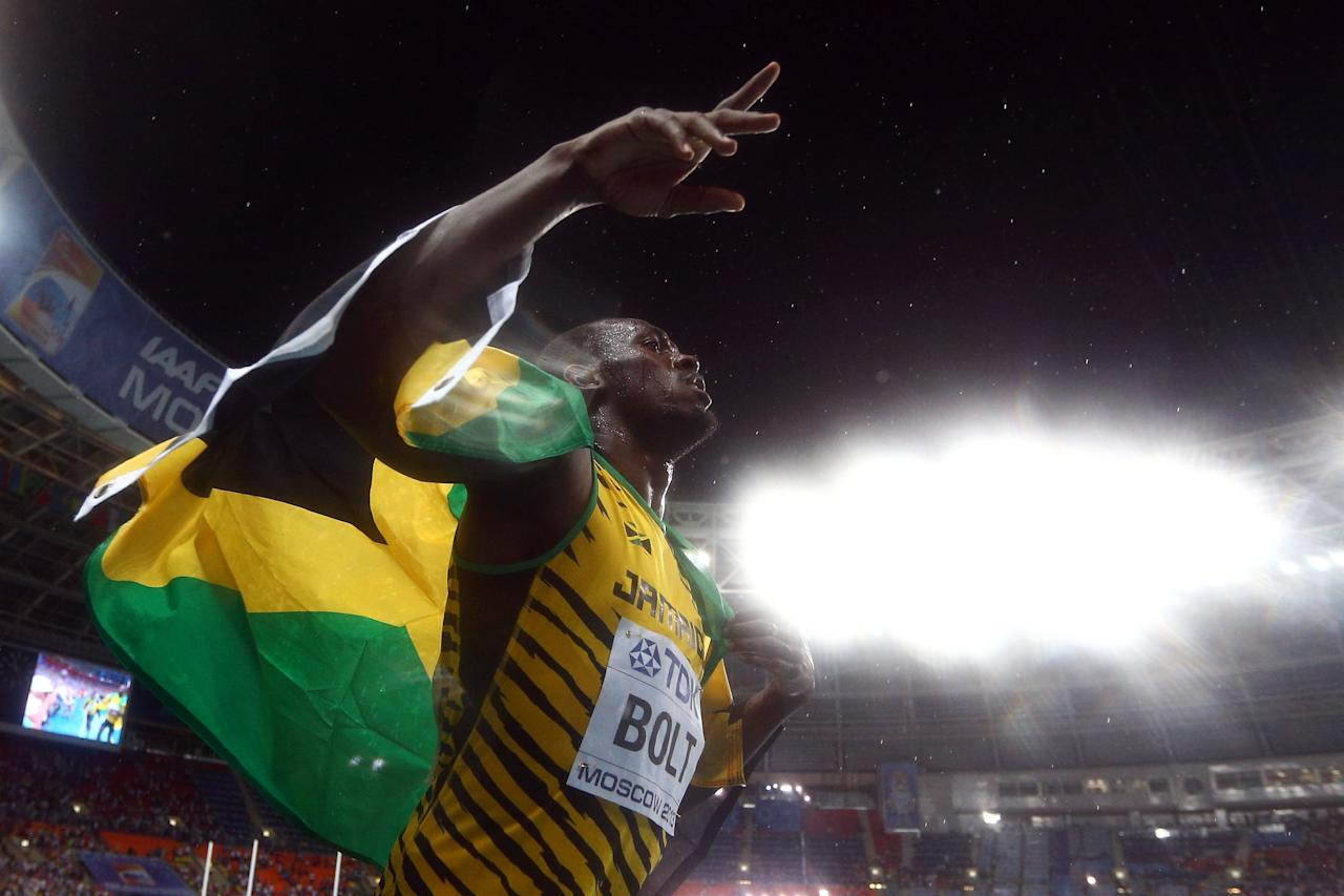 MOSCOW, RUSSIA - AUGUST 11: Usain Bolt of Jamaica celebrates winning gold in the Men's 100 metres Final during Day Two of the 14th IAAF World Athletics Championships Moscow 2013 at Luzhniki Stadium on August 11, 2013 in Moscow, Russia. (Photo by Cameron Spencer/Getty Images)