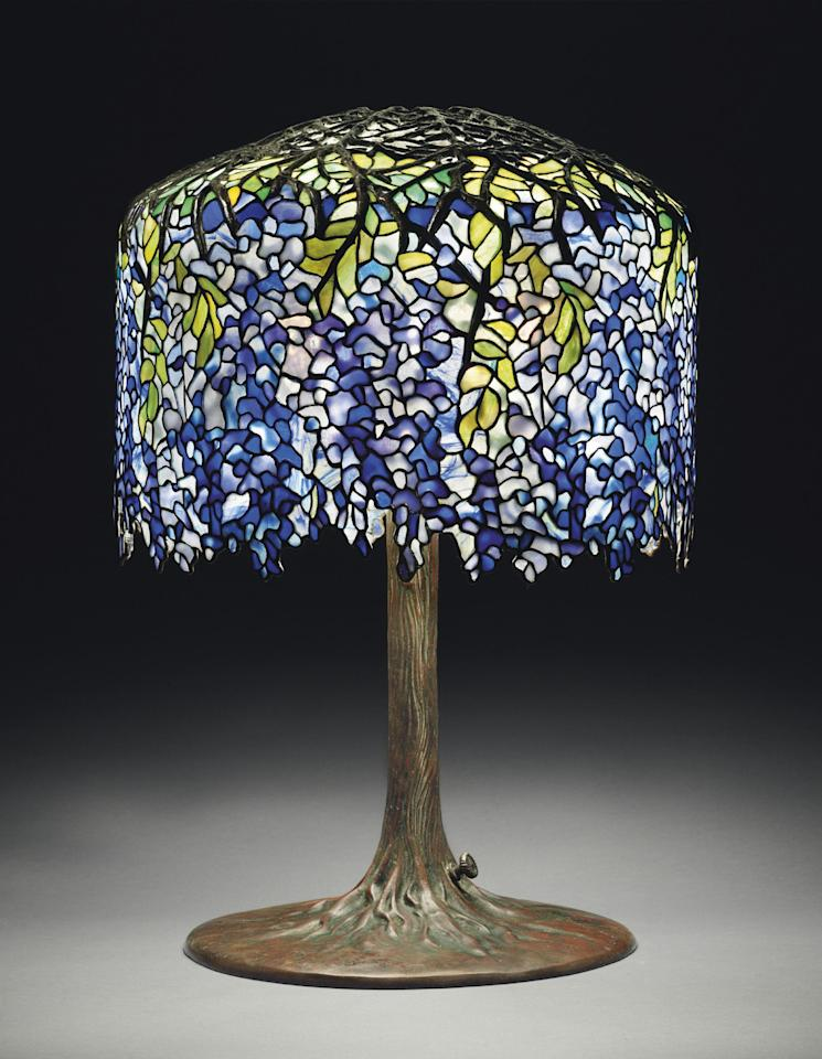 "This undated photo provided by Christie's shows Tiffany's circa 1910 ""Wisteria"" leaded glass and bronze table lamp in deep purples, violets and blues. The lamp, which graced San Francisco's popular Eddie Rickenbacker bar, is being sold on June 14th by Christie's auction house in New York. Eddie Rickenbacker's colorful proprietor, Norman Jay Hobday, died in February 2011. Hobday's Tiffany collection of six lamps and one chandelier is expected to bring more than $2 million on June 14. (AP Photo/Christie's)"