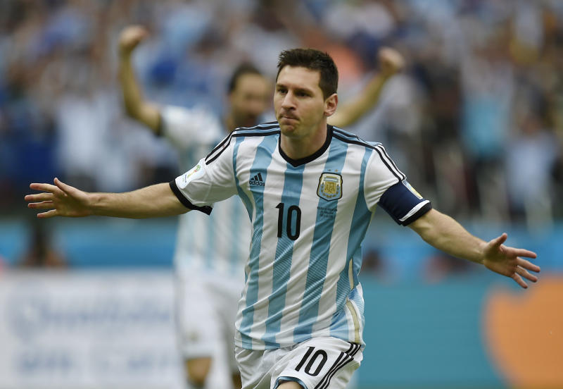 Argentina's Lionel Messi celebrates after scoring his side's first goal during the group F World Cup soccer match against Nigeria at the Estadio Beira-Rio in Porto Alegre, Brazil, Wednesday, June 25, 2014