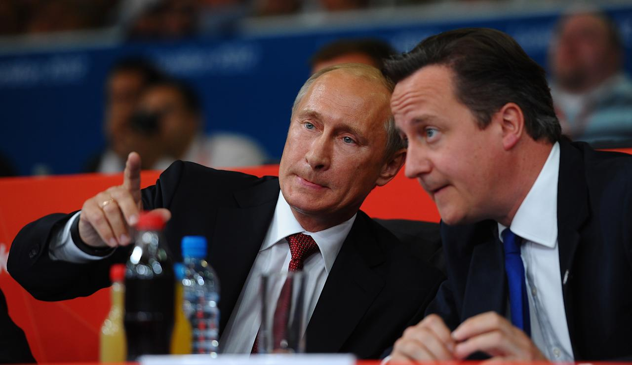 LONDON, ENGLAND - AUGUST 02:  Russian President Vladimir Putin (L) watches Judo with British Prime Minister David Cameron on Day 6 of the London 2012 Olympic Games at ExCeL on August 2, 2012 in London, England.  (Photo by Laurence Griffiths/Getty Images)