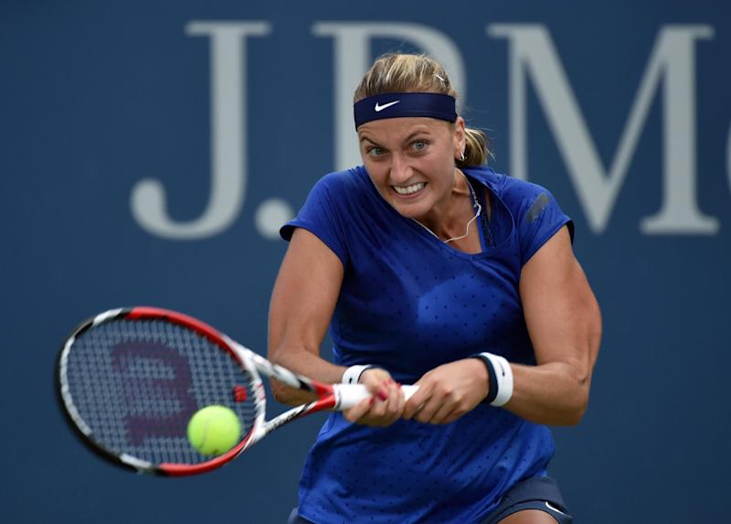Petra Kvitova of the Czech Republic returns a shot to Petra Cetkovska of the Czech Republic during their 2014 US Open women's singles match on August 28, 2014 in New York
