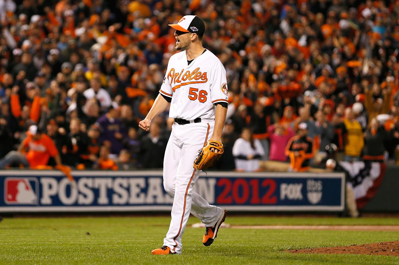 BALTIMORE, MD - OCTOBER 07:  Darren O'Day #56 of the Baltimore Orioles reacts after he struck out Alex Rodriguez #13 of the New York Yankees to end the top of the seventh inning during Game One of the American League Division Series at Oriole Park at Camden Yards on October 7, 2012 in Baltimore, Maryland.  (Photo by Rob Carr/Getty Images)