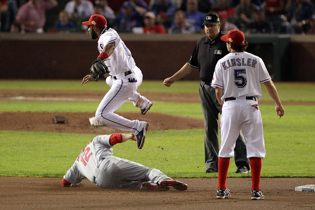 ARLINGTON, TX - OCTOBER 23: Elvis Andrus #1 of the Texas Rangers turns the double play as Lance Berkman #12 of the St. Louis Cardinals slides into second base in the fifth inning during Game Four of the MLB World Series at Rangers Ballpark in Arlington on October 23, 2011 in Arlington, Texas.  (Photo by Ezra Shaw/Getty Images)