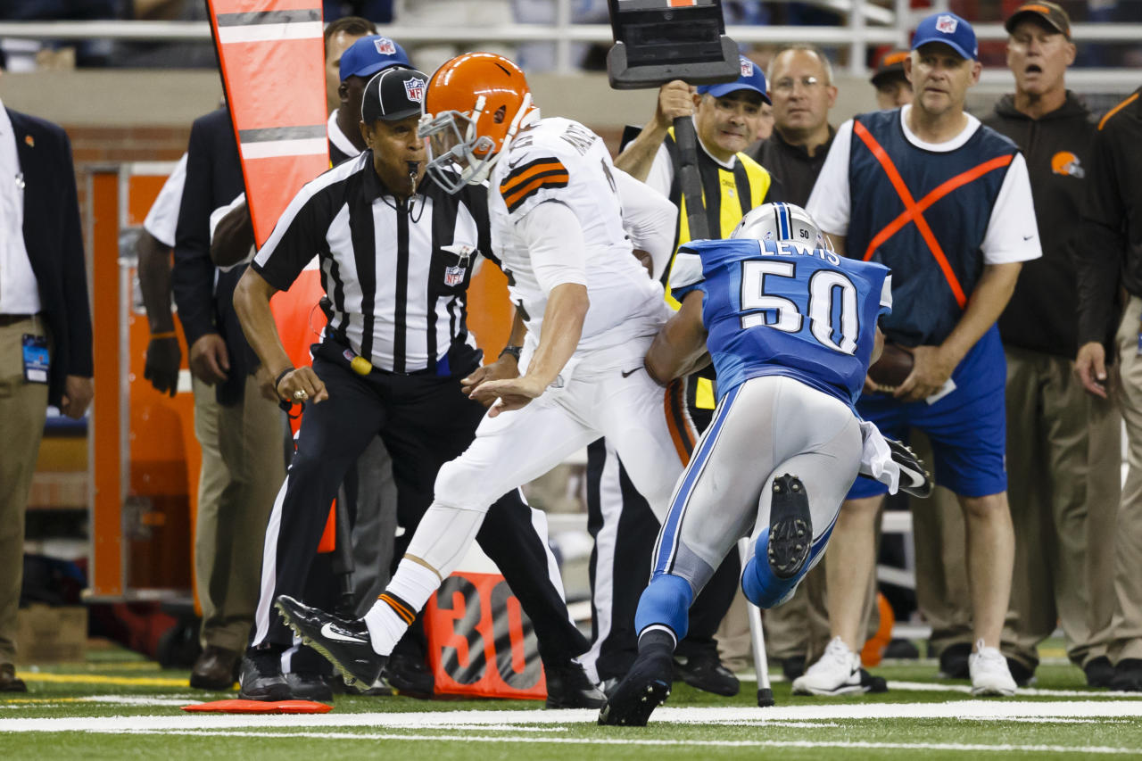 Cleveland Browns quarterback Johnny Manziel (2) ifs forces out of bounds by Detroit Lions linebacker Travis Lewis (50) during a preseason NFL football game at Ford Field in Detroit, Saturday, Aug. 9, 2014. (AP Photo/Rick Osentoski)