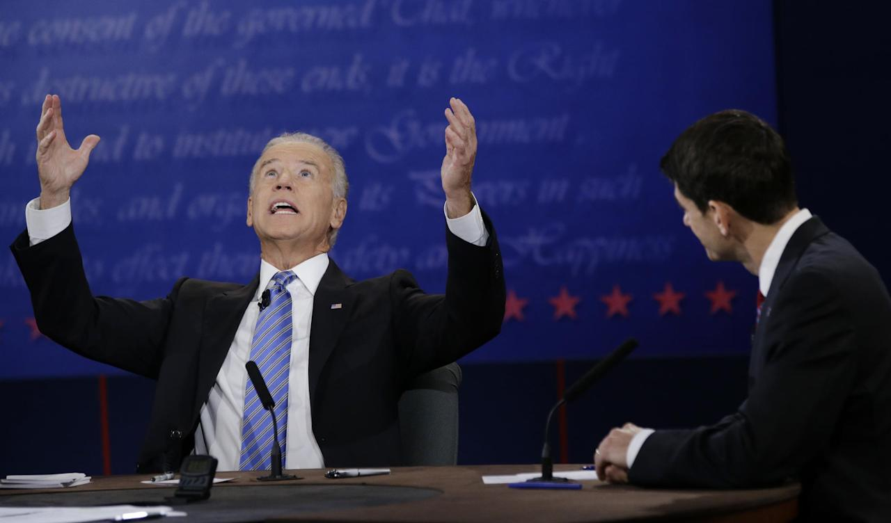 Republican vice presidential nominee Rep. Paul Ryan, of Wisconsin, right, watches as Vice President Joe Biden, speaks during the vice presidential debate at Centre College, Thursday, Oct. 11, 2012, in Danville, Ky. (AP Photo/David Goldman)