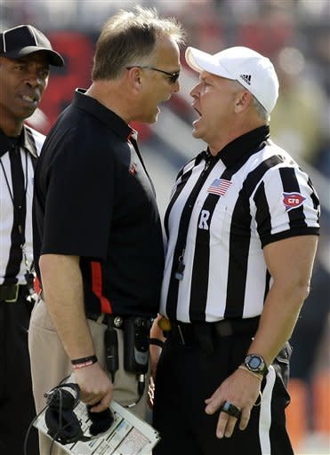Georgia head coach Mark Richt, left, has words with referee Mike Defee during the first half of the Capital One Bowl NCAA football game against Nebraska, Tuesday, Jan. 1, 2013, in Orlando, Fla. (AP Photo/John Raoux)