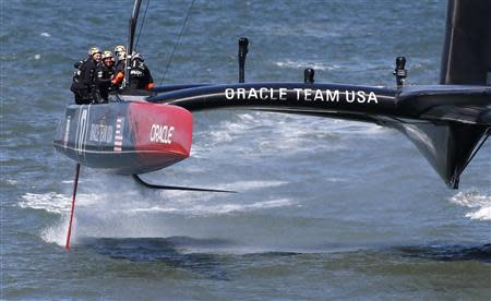 Members of the Oracle Team USA compete enroute to winning the overall title of the 34th America's Cup yacht sailing race over Emirates Team New Zealand in San Francisco