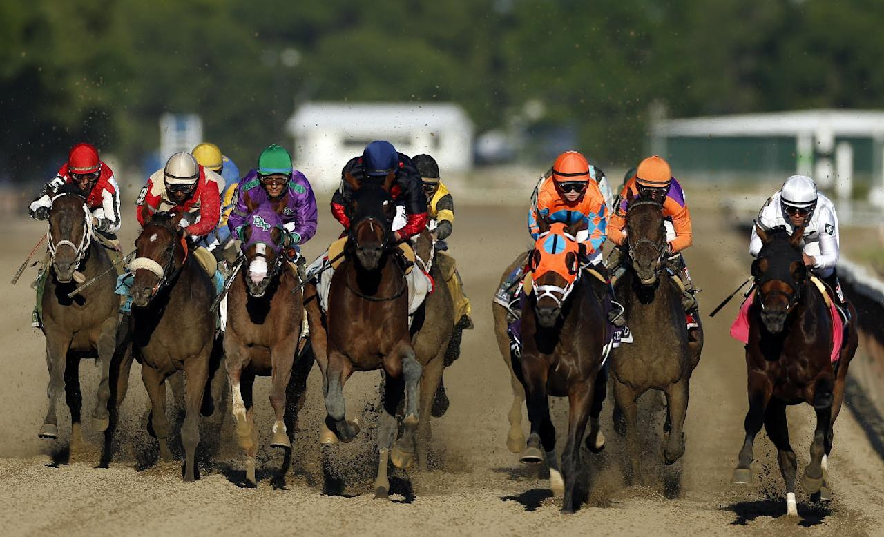 California Chrome, third from left,, is flanked by Wicked Strong and Tonalist as they run down the backstretch during the 146th running of the Belmont Stakes horse race at Belmont Park, Saturday, June 7, 2014, in Elmont, N.Y.  Tonalist went on to win the race, denying California Chrome the Triple Crown victory. (AP Photo/Jason DeCrow)