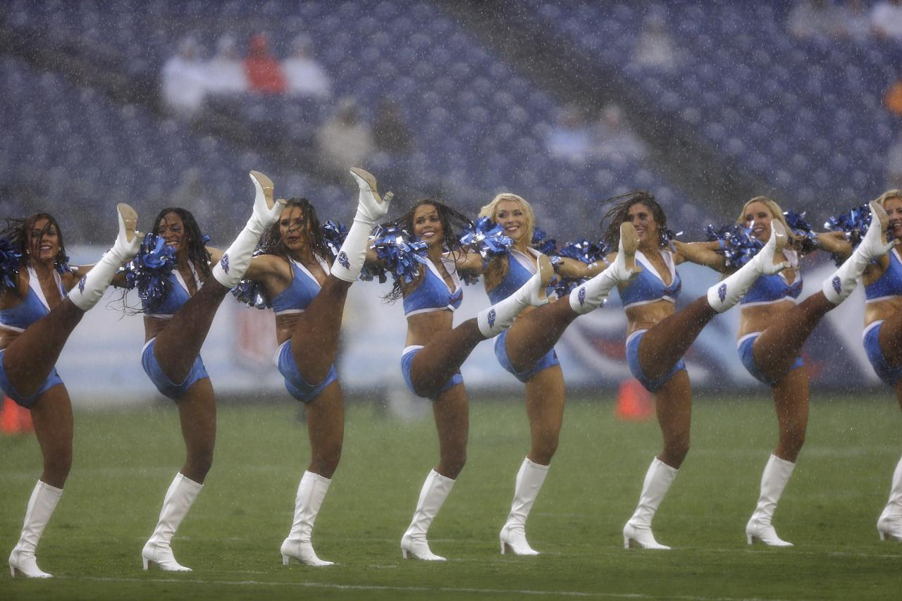 Tennessee Titans cheerleaders perform in the rain before a preseason NFL football game against the Green Bay Packers, Saturday, Aug. 9, 2014, in Nashville, Tenn. (AP Photo/Wade Payne)