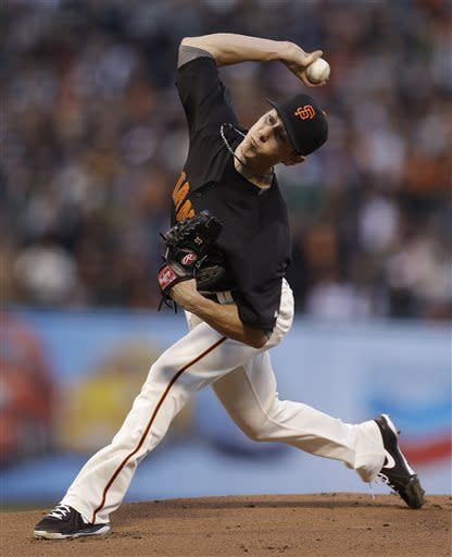 Lincecum labors, Giants lose to A's 7-3
