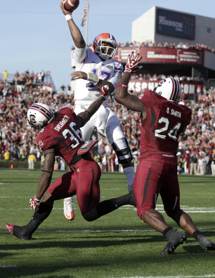 South Carolina safety D.J. Swearinger, left, and linebacker Quin Smith, right, rush Florida quarterback Jacoby Brissett, center, as he attempts to throw for a two- point conversion during the fourth quarter of a NCAA college football game, Saturday, Nov. 12, 2011, at Williams-Brice Stadium in Columbia, S.C. (AP Photo/Brett Flashnick)