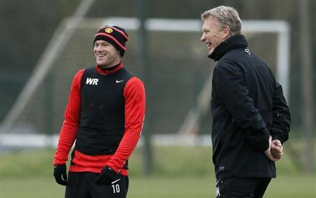 Manchester United's Moyes and Rooney smile during a training session in Manchester