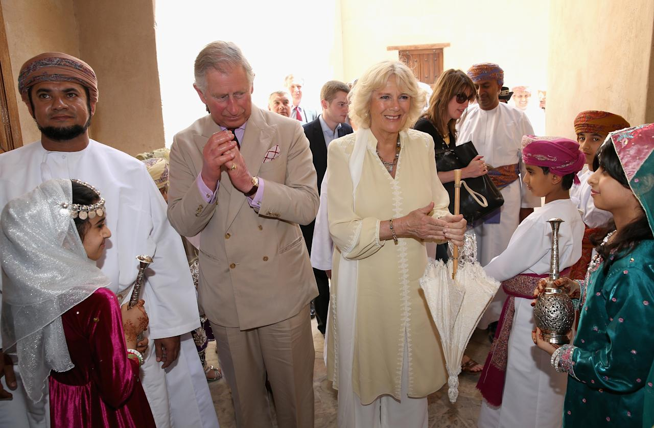 NIZWA, OMAN - MARCH 18:  Prince Charles, Prince of Wales and Camilla, Duchess of Cornwall wash their hands as they visit Nizwa Fort on the eighth day of a tour of the Middle East on March 18, 2013 in Nizwa, Oman. The Royal couple are on the fourth and final leg of a tour of the Middle East taking in Jordan, Qatar, Saudia Arabia and Oman.  (Photo by Chris Jackson/Getty Images)
