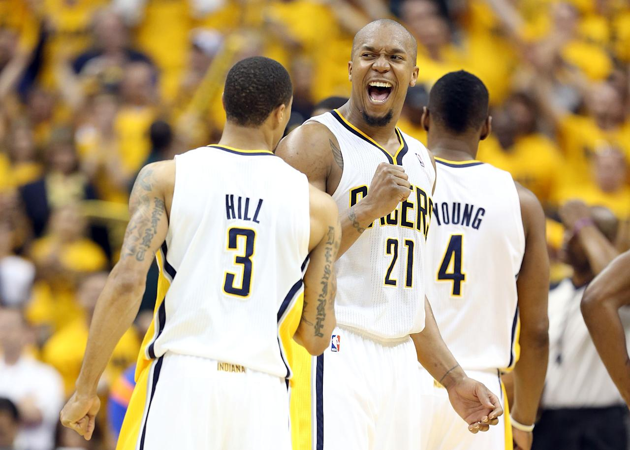 INDIANAPOLIS, IN - MAY 18:  David West #21 and George Hill #3 of the Indiana Pacers celebrate in the game against the New York Knicks during Game Six of the Eastern Conference Semifinals of the 2013 NBA Playoffs at Bankers Life Fieldhouse on May 18, 2013 in Indianapolis, Indiana.The Pacers won 106-99. NOTE TO USER: User expressly acknowledges and agrees that, by downloading and or using this photograph, User is consenting to the terms and conditions of the Getty Images License Agreement.  (Photo by Andy Lyons/Getty Images)