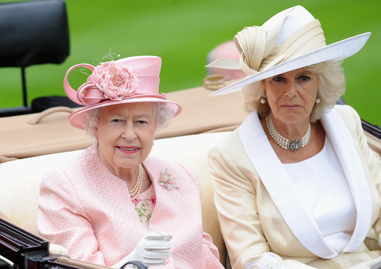 ASCOT, ENGLAND - JUNE 18: Queen Elizabeth II & Camilla, Duchess Of Cornwall attends day one of Royal Ascot at Ascot Racecourse on June 18, 2013 in Ascot, England. (Photo by Stuart C. Wilson/Getty Images for Ascot Racecourse)