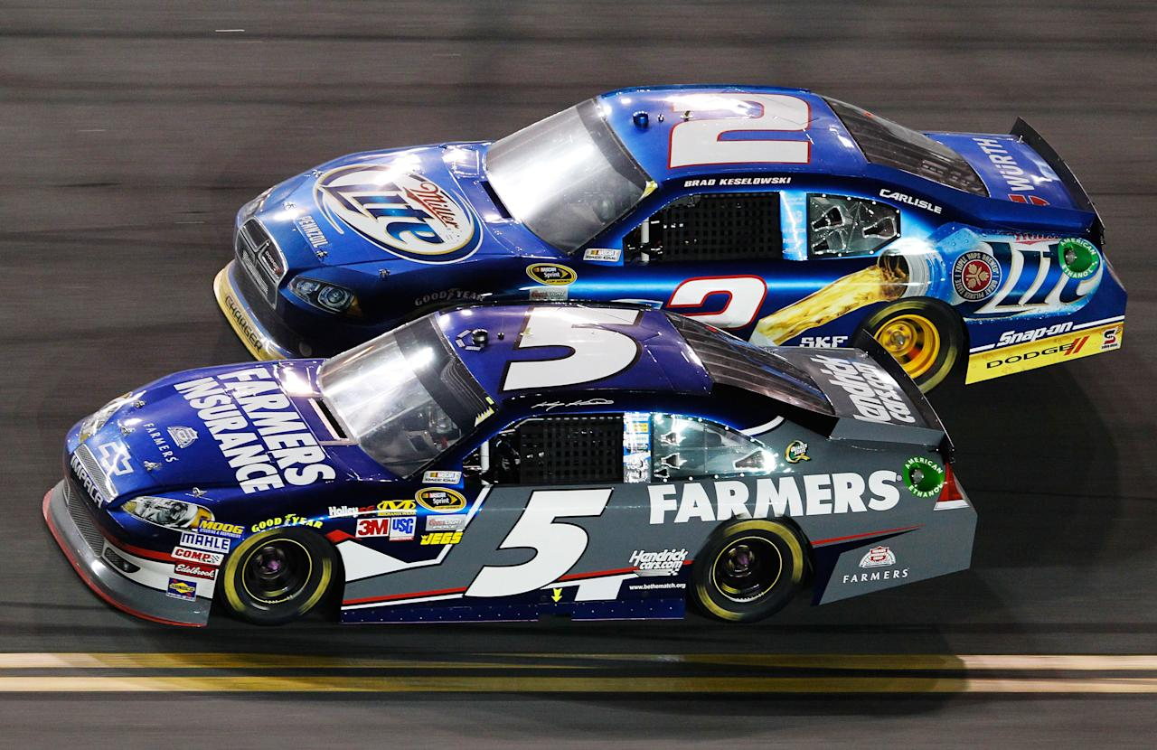 DAYTONA BEACH, FL - FEBRUARY 27:  Kasey Kahne, driver of the #5 Farmers Insurance Chevrolet, and Brad Keselowski, driver of the #2 Miller Lite Dodge, race during the NASCAR Sprint Cup Series Daytona 500 at Daytona International Speedway on February 27, 2012 in Daytona Beach, Florida.  (Photo by Streeter Lecka/Getty Images)
