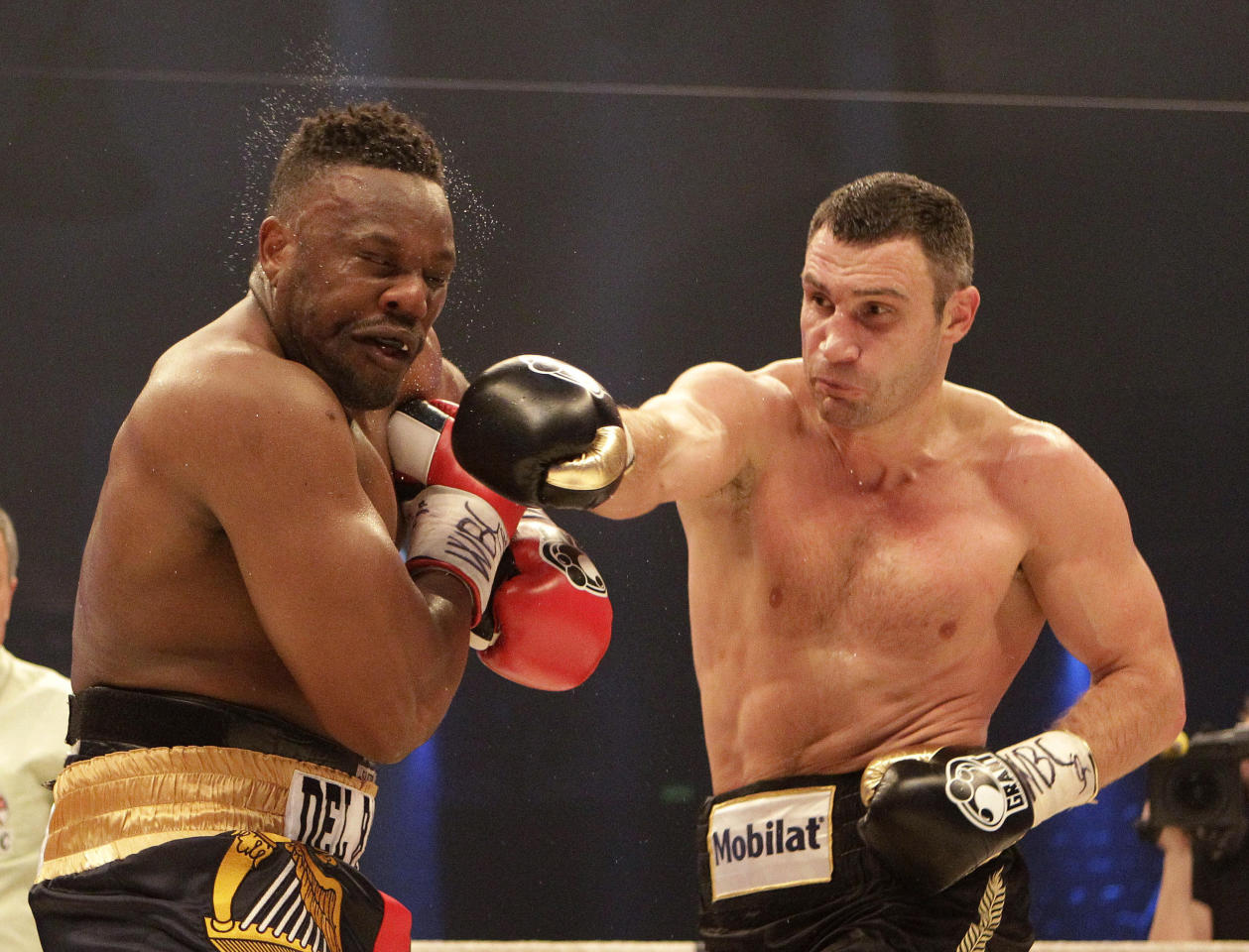 WBC heavyweight Champion Vitali Klitschko of Ukraine, right, punches challenger Dereck Chisora of Britain during their WBC heavyweight title boxing bout at the Olympic hall in Munich, Germany , Saturday, Feb. 18, 2012. (AP Photo/Frank Augstein)