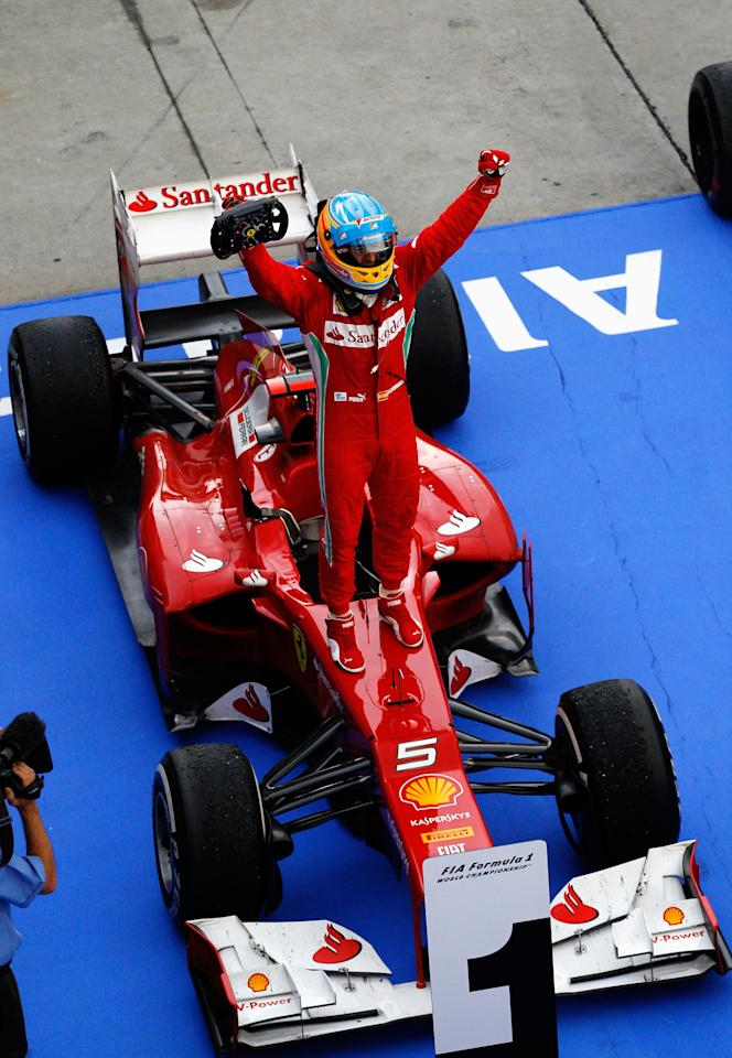 KUALA LUMPUR, MALAYSIA - MARCH 25:  Fernando Alonso of Spain and Ferrari celebrates in parc ferme after winning the Malaysian Formula One Grand Prix at the Sepang Circuit on March 25, 2012 in Kuala Lumpur, Malaysia.  (Photo by Paul Gilham/Getty Images)