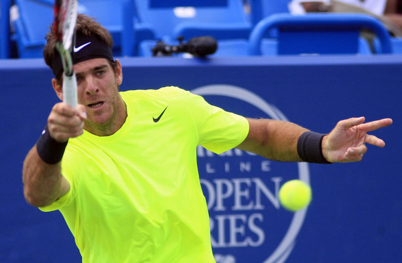 Juan Martin del Potro, from Argentina, hits a forehand shot against Novak Djokovic, from Serbia, during a semifinal match at the Western & Southern Open tennis tournament, Saturday, Aug. 18, 2012, in Mason, Ohio. (AP Photo/Al Behrman)