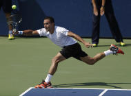 Victor Estrella Burgos, of Dominican Republic, returns a shot against Igor Sijsling, of the Netherlands, during the first round of the 2014 U.S. Open tennis tournament, Tuesday, Aug. 26, 2014, in New York. (AP Photo/Darron Cummings)