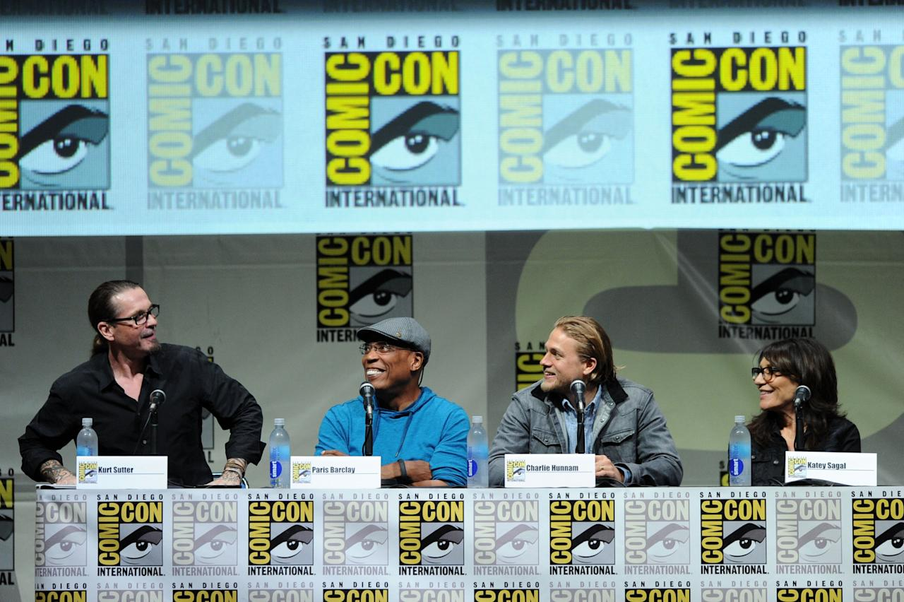 """SAN DIEGO, CA - JULY 21: (L-R) Writer/producer Kurt Sutter, director/producer Paris Barclay and actors Charlie Hunnam and Katey Sagal speak onstage at the """"Sons Of Anarchy"""" panel during Comic-Con International 2013 at San Diego Convention Center on July 21, 2013 in San Diego, California. (Photo by Kevin Winter/Getty Images)"""